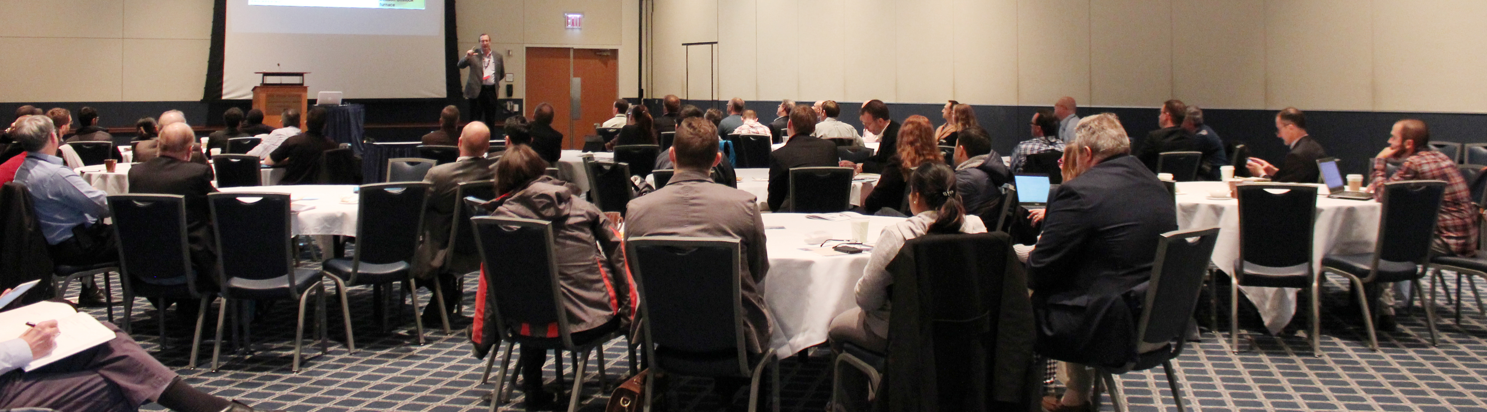 Conference attendees listening to keynote speaker, Dr. John Straube