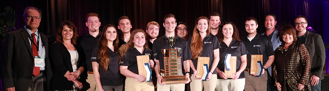 Students with first place trophy