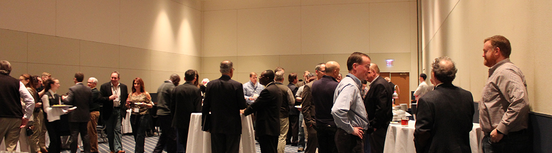 People networking at evening reception