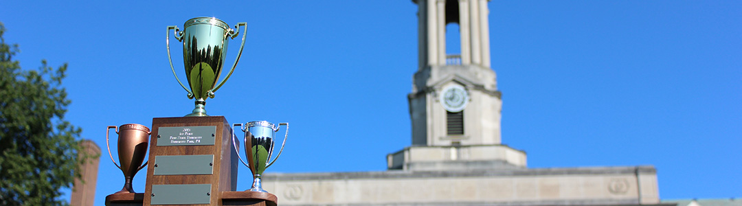 Trophy in front of Old Main